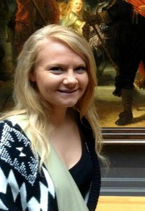 "Alison Ranniger, NCAG Summer Intern in front of Rembrandt's ""The Nightwatch"""