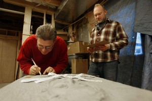 Troy Muller, right, and Billy Marples work on a bronze relief on Oct. 31, 2008 --OWH