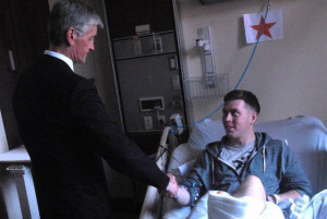 PFC Kyle Foster being visited by Secretary of the Army in 2011 while recovering from his combat injuries.
