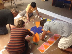 Veterans make sand painting.