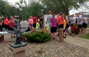 Runners gather in Kimballton's Little Mermaid Park after completing a race.