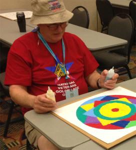Workshop participant completing artwork