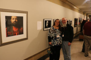 Mentor Larry Ferguson and mentee Erin Colson pose in front of their work. Photo Courtesy Joslyn Art Museum